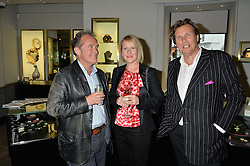 Left to right, JONATHAN MAITLAND, his wife HELENA and THEO FENNELL at a party to celebrate the publication of the Summer edition og the Fitzdares Times held at Theo Fennell, 169 Fulham Road, London on 13th June 2016.