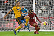 Wolverhampton Wanderers Romain Saiss blocks the ball from Liverpool forward Mohamed Salah during the Premier League match between Wolverhampton Wanderers and Liverpool at Molineux, Wolverhampton, England on 21 December 2018.