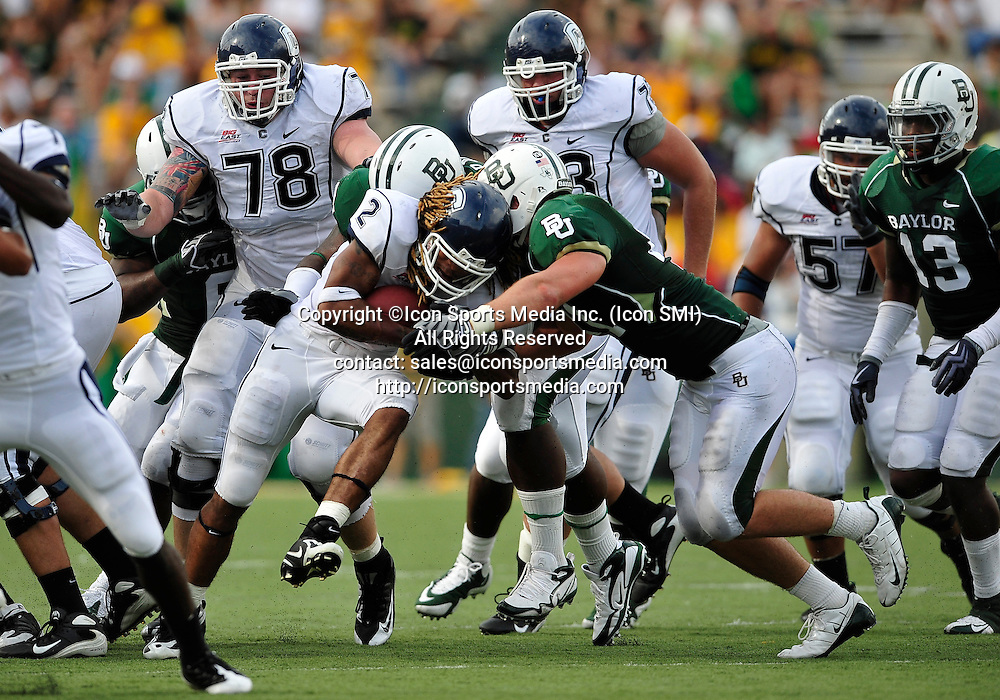 September 19th 2009:  <br /> Connecticut running back Andre Dixon (2)<br /> in action during a NCAA Football game between the Baylor Bears and the University of Connecticut at Floyd Casey  Stadium in Waco, TX.  <br /> Baylor loses to UConn 30-22
