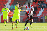 Jay Harris and Amari Morgan-Smith during the Vanarama National League match between Cheltenham Town and Tranmere Rovers at Whaddon Road, Cheltenham, England on 26 September 2015. Photo by Antony Thompson.