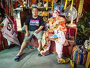 """26 NOVEMBER 2014 - BANGKOK, THAILAND:  Performers wait for the Chinese opera to start at the Chow Su Kong Shrine in the Talat Noi neighborhood of Bangkok. Chinese opera was once very popular in Thailand, where it is called """"Ngiew."""" It is usually performed in the Teochew language. Millions of Chinese emigrated to Thailand (then Siam) in the 18th and 19th centuries and brought their culture with them. Recently the popularity of ngiew has faded as people turn to performances of opera on DVD or movies. There are about 30 Chinese opera troupes left in Bangkok and its environs. They are especially busy during Chinese New Year and Chinese holidays when they travel from Chinese temple to Chinese temple performing on stages they put up in streets near the temple, sometimes sleeping on hammocks they sling under their stage.     PHOTO BY JACK KURTZ"""