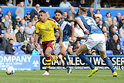 Burnley striker Andre Gray gets away from Birmingham City defender Michael Morrison and Birmingham City defender Ryan Shotton during the Sky Bet Championship match between Birmingham City and Burnley at St Andrews, Birmingham, England on 16 April 2016. Photo by Alan Franklin.