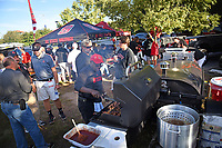 NC State fans tailgate prior to a Wolfpack football game at Carter-Finley Stadium.