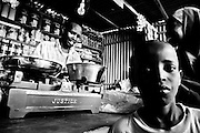 Malnutrition in the Horn of Africa.<br /> <br /> A young boy looks into the camera while his mother buys food into a shop at the State House Refugee Camp of Hargeisa, the capital city of Somaliland in the Horn of Africa.<br /> The Northern region of former Somalia Republic reached its independence from the southern part in 1988 after a long period of civil war, but it is not actually recognized by any international country and community.     <br /> Hargeisa, Somaliland - 08th Aug 2011<br /> © Giorgio Perottino