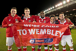 Bristol City players celebrate getting to wembley after beating Gillingham in the Johnstone Paint Trophy area southern final.<br /> <br /> From Left to right - Matt Smith, Aden Flint, Jay Emmanuel-Thomas, Korey Smith, Derrick Williams<br /> <br />  - Photo mandatory by-line: Dougie Allward/JMP - Mobile: 07966 386802 - 29/01/2015 - SPORT - Football - Bristol - Ashton Gate - Bristol City v Gillingham - Johnstone Paint Trophy