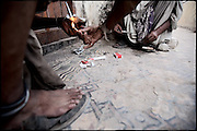 "An quite hidden place, on the second floor of a building, where two homeless can consume their heroin. Shan Nazar Kapull, Rawalpindi, Pakistan, on friday, August 29 2008.....""Pakistan is one of the countries hardest hits by the narcotics abuse into the world, during the last years it is facing a dramatic crisis as it regards the heroin consumption. The Unodc (United Nations Office on Drugs and Crime) has reported a conspicuous decline in heroin production in Southeast Asia, while damage to a big expansion in Southwest Asia. Pakistan falls under the Golden Crescent, which is one of the two major illicit opium producing centres in Asia, situated in the mountain area at the borderline between Iran, Afghanistan and Pakistan itself. .During the last 20 years drug trafficking is flourishing in the Country. It is the key transit point for Afghan drugs, including heroin, opium, morphine, and hashish, bound for Western countries, the Arab states of the Persian Gulf and Africa..Hashish and heroin seem to be the preferred drugs prevalence among males in the age bracket of 15-45 years, women comprise only 3%. More then 5% of whole country's population (constituted by around 170 milion individuals),  are regular heroin users, this abuse is conspicuous as more of an urban phenomenon. The substance is usually smoked or the smoke is inhaled, while small number of injection cases have begun to emerge in some few areas..Statistics say, drug addicts have six years of education. Heroin has been identified as the drug predominantly responsible for creating unrest in the society."""