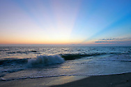 The light show is just beginning when the sun falls beneath the horizon of the Gulf of Mexico on Sanibel Island, Florida.
