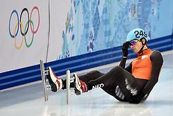 21-02-2014 SHORTTRACK: OLYMPIC GAMES: SOTSJI<br /> Freek van der Wart redt het niet om de finale van de 500 meter te halen. In de kwartfinale wordt hij onderuit gereden door de Rus <br /> ©2014-FotoHoogendoorn.nl