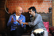 Birmingham, England. 23rd. October, 2016. <br /> Dave Rogers and Mukhtar Dar, in discussion during the 'Up Close and Personal' concert, produced by Kalaboration as part of their Bridges Across Borders series of events in Kings Heath Birmingham.<br /> Photographer, Kevin Hayes