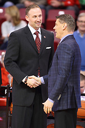 06 January 2016: Dan Muller and Porter Moser greet each other, shake hands and exchange pleasantries before the basketball game between the Illinois State Redbirds v Loyola-Chicago Ramblers at Redbird Arena in Normal Illinois (Photo by Alan Look)