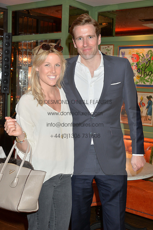 PICTURE SHOWS:-WILF FROST and ALICE PEARSON-WRIGHT.<br /> Tuesday 14th April 2015 saw a host of London influencers and VIP faces gather together to celebrate the launch of The Ivy Chelsea Garden. Live entertainment was provided by jazz-trio The Blind Tigers, whilst guests enjoyed Mo&euml;t &amp; Chandon Champagne, alongside a series of delicious canap&eacute;s created by the restaurant&rsquo;s Executive Chef, Sean Burbidge.<br /> The evening showcased The Ivy Chelsea Garden to two hundred VIPs and Chelsea<br /> residents, inviting guests to preview the restaurant and gardens which marry<br /> approachable sophistication and familiar luxury with an underlying feeling of glamour and theatre. The Ivy Chelsea Garden&rsquo;s interiors have been designed by Martin Brudnizki Design Studio, and cleverly combine vintage with luxury, resulting in a space that is both alluring and down-to-earth.