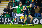 Alex Gogic (#13) of Hamilton Academical FC and Christian Doidge (#9) of Hibernian FC tussle for the ball during the Ladbrokes Scottish Premiership match between Hibernian FC and Hamilton Academical FC at Easter Road Stadium, Edinburgh, Scotland on 22 January 2020.