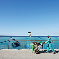A worker walks along Corniche Beirut in Beirut, Lebanon.