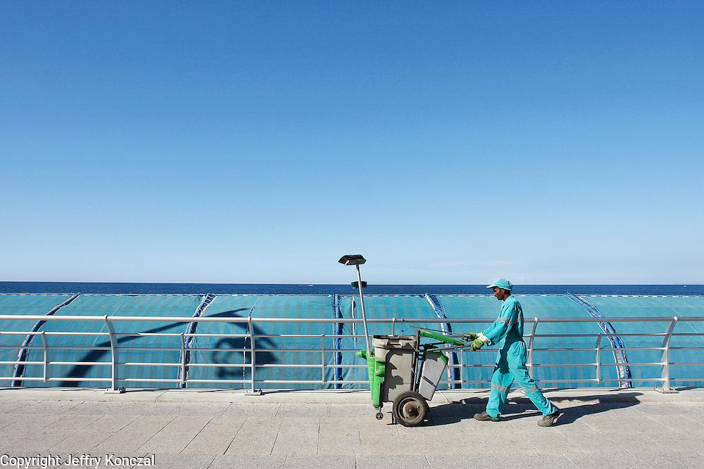 A worker walks along Corniche Beirut in Beirut, Lebanon.