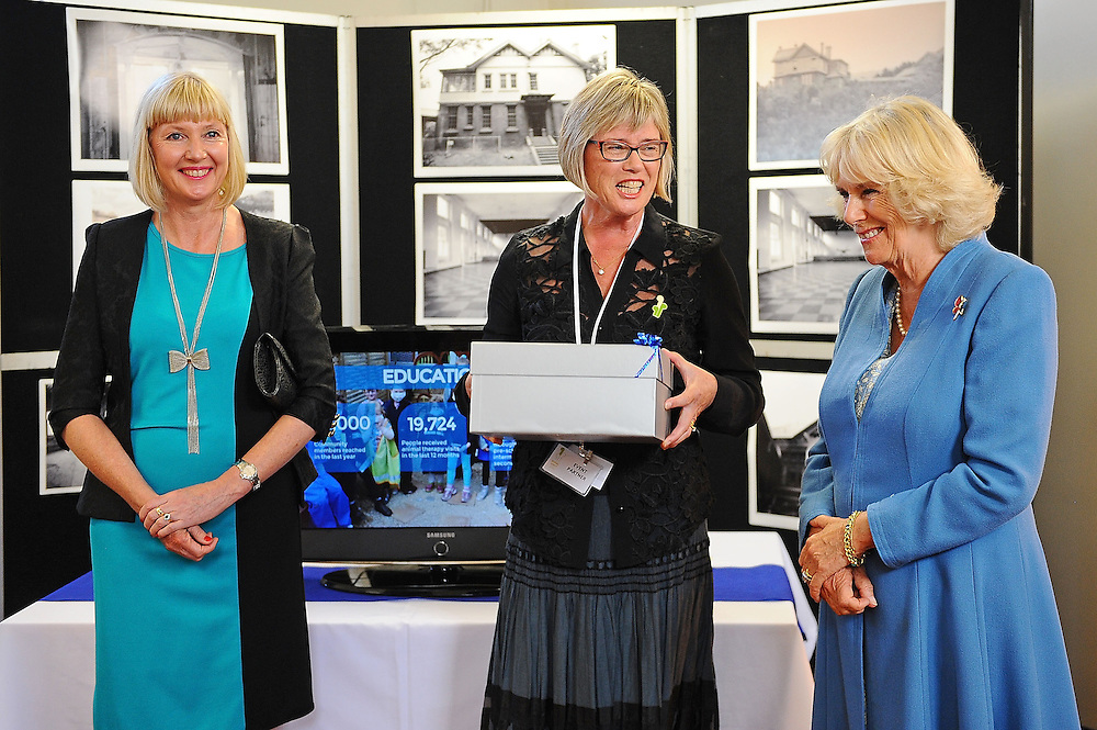 Lady Janine Mateparae, left and Kerry Prendergastmake a presentation to Camilla, Duchess of Cornwall wbhile visiting the Wellington SPCA, Wellington, New Zealand, Saturday, November 07, 2015. Credit:SNPA / Getty, Mark Tantrum **POOL**