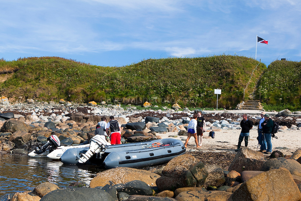 Visitors arrive at the anchorage and landing on the north side of the Great Saltee, the larger of the Saltee Islands, off the coast of Co. Wexford, Ireland.