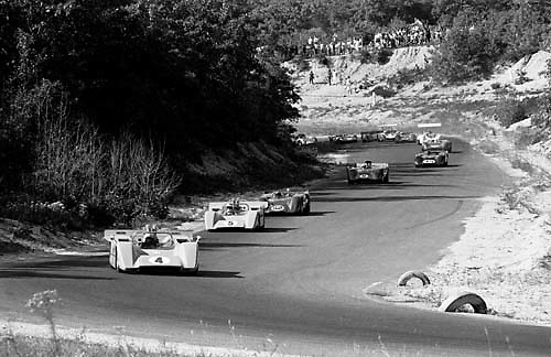 Bruce McLaren (no 4) and Denny Hulme (no. 5) lead the pack through Echo Valley halfway around the opening lap of the 1968 Bridgehampton Can-Am. Peter Revson's McLaren (no. 52) is third ahead of eventual winner Mark Donohue's McLaren (no. 6).