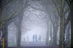 ©Licensed to London News Pictures 01/01/2020<br /> Sidcup ,UK.Early morning dog walkers stopping for a chat. New years day foggy weather at Footscray Meadows in Sidcup, South East London this morning.Photo credit: Grant Falvey/LNP