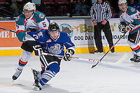 KELOWNA, CANADA -FEBRUARY 8: Dalton Yorke #5 of the Kelowna Rockets checks Tyler Soy #17 of the Victoria Royals during the third period on February 8, 2014 at Prospera Place in Kelowna, British Columbia, Canada.   (Photo by Marissa Baecker/Getty Images)  *** Local Caption *** Dalton Yorke; Tyler Soy;