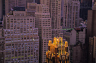 New York. elevated view on midtown. the american standart - radiator - building with a gold rooftop , rockfeller center area in the distance, / le radiator building au sommet d or en arriere plan le quartier du Rockfeller center panorama sur  midtown    New york