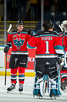 KELOWNA, CANADA - NOVEMBER 21: Mark Liwiski #9 fist bumps James Porter #1 of the Kelowna Rockets after the win against the Regina Pats  on November 21, 2018 at Prospera Place in Kelowna, British Columbia, Canada.  (Photo by Marissa Baecker/Shoot the Breeze)