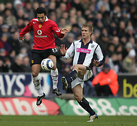 Photo: Lee Earle.<br /> West Bromwich Albion v Manchester United. The Barclays Premiership. 18/03/2006. United's Kieran Richardson (L) battles with Martin Albrechtsen.