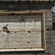 July 2016<br /> Bullet holes damaged the inscription on the central plaque. <br /> Photo: Hashmatullah Ahmadi.