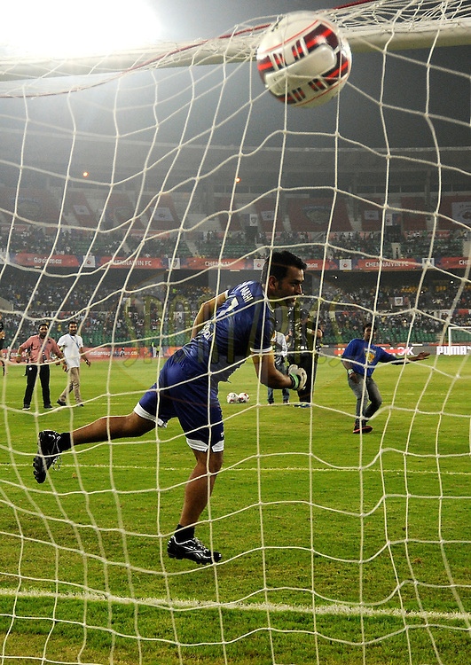 Mahendra Singh Dhoni co-owner of Chennaiyin FC and Indian Cricket captain in action during the break during match 15 of the Hero Indian Super League between Chennaiyin FC and Mumbai City FC held at the Jawaharlal Nehru Stadium, Chennai, India on the 28th October 2014.<br /> <br /> Photo by:  Pal Pillai/ ISL/ SPORTZPICS
