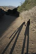 Shadows of Hagar and Andrew, hiking at sunset, Malibu, Summer 2010.