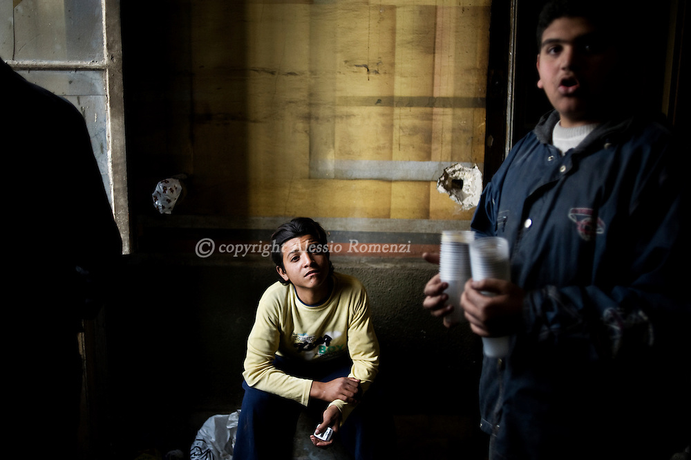 Children inside one of the building occupied by anti-gouvernment protestors  in Tahrir square in Cairo on February 04, 2010.© ALESSIO ROMENZI