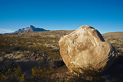 Boulder below south face of El Capitan peak, at 8,085 feet in Guadalupe Mountains National Park, Texas, USA.  South face of El Capitan peak, at 8,085 feet in Guadalupe Mountains National Park, Texas, USA.
