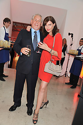 SIMON KELNER and RONNI ANCONA at a dinner in aid The Journalism Foundation held at Philips De Pury & Company, Howick Place, London, SW1 on 22nd May 2012.