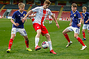 Kacper Kozlowski holds off Connor Barron (Aberdeen)  during the U17 European Championships match between Scotland and Poland at Firhill Stadium, Maryhill, Scotland on 26 March 2019.