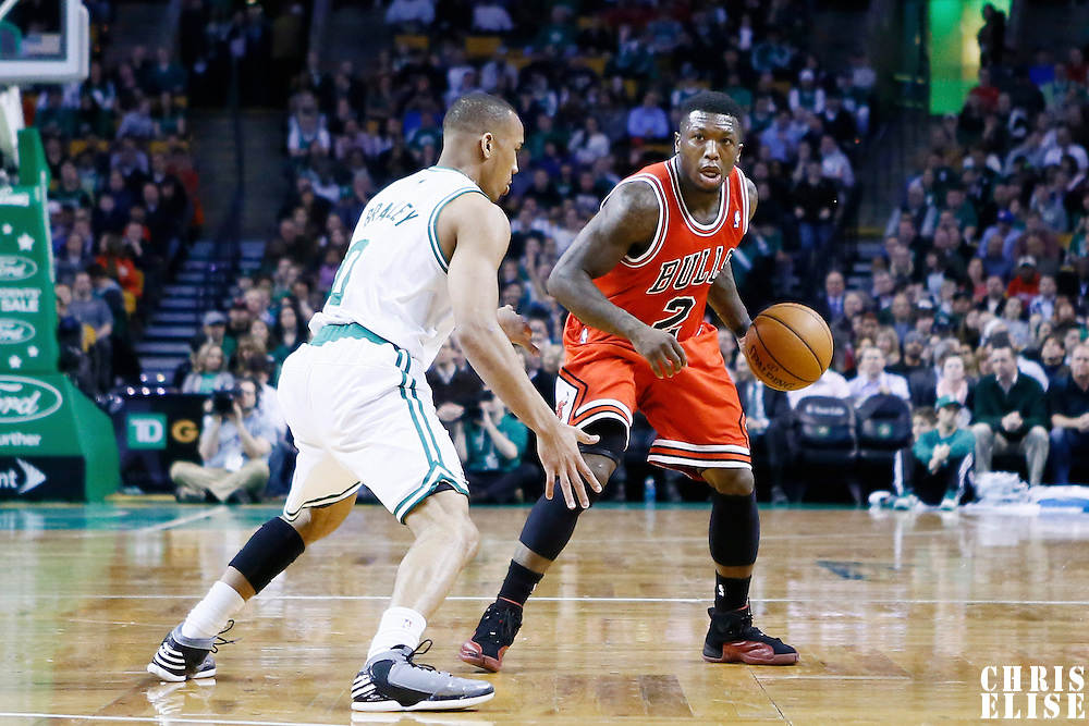 13 February 2013: Chicago Bulls point guard Nate Robinson (2) looks to pass the ball over Boston Celtics point guard Avery Bradley (0) during the Boston Celtics 71-69 victory over the Chicago Bulls at the TD Garden, Boston, Massachusetts, USA.