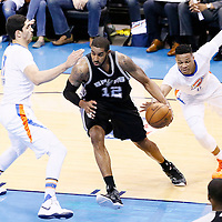 06 May 2016: San Antonio Spurs forward LaMarcus Aldridge (12) drives past Oklahoma City Thunder center Enes Kanter (11) during the San Antonio Spurs 100-96 victory over the Oklahoma City Thunder, during Game Three of the Western Conference Semifinals of the NBA Playoffs at the Chesapeake Energy Arena, Oklahoma City, Oklahoma, USA.
