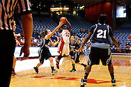 UD senior Kayla Moses (23) takes a shot as the Rhode Island Rams play the University of Dayton Flyers at UD Arena in Dayton, Saturday, January 7, 2012.