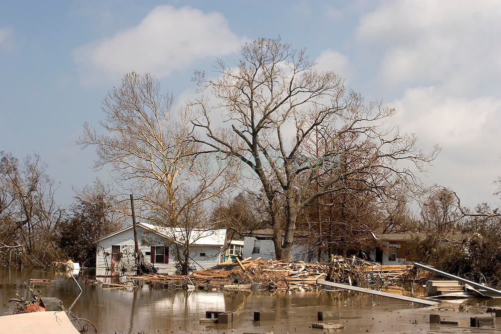26th Sept, 2005. Cameron, Louisiana. Hurricane Rita aftermath.<br /> Oil and chemical pollutants infiltrate the destroyed remains of houses and business in Cameron, Louisiana. Two days after the storm ravaged the small town.<br /> Photo; ©Charlie Varley/varleypix.com