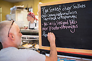 Jeff Barney adds the daily specials to the board at The Saxapahaw General Store.