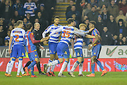 Reading FC players confront Crystal Palace midfielder Wilfried Zaha during the The FA Cup Quarter Final match between Reading and Crystal Palace at the Madejski Stadium, Reading, England on 11 March 2016. Photo by Mark Davies.