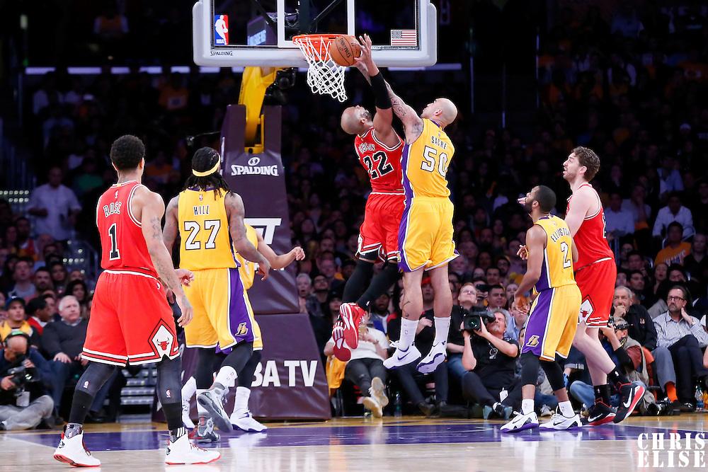 29 January 2015: Chicago Bulls forward Taj Gibson (22) is blocked by Los Angeles Lakers center Robert Sacre (50) during the Los Angeles Lakers 123-118 2OT victory over the Chicago Bulls, at the Staples Center, Los Angeles, California, USA.