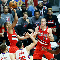 09 November 2016: Portland Trail Blazers guard C.J. McCollum (3) takes a jump shot over Los Angeles Clippers forward Blake Griffin (32), Los Angeles Clippers guard Austin Rivers (25) and Los Angeles Clippers center DeAndre Jordan (6) during the LA Clippers 111-80 victory over the Portland Trail Blazers, at the Staples Center, Los Angeles, California, USA.