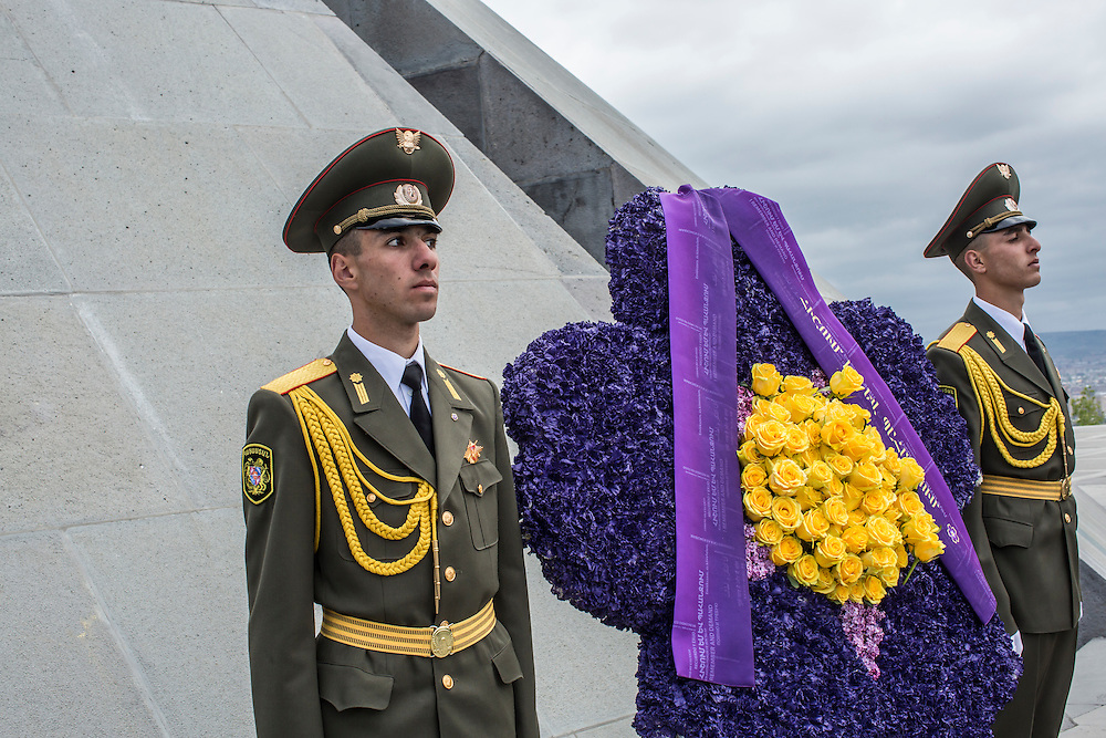YEREVAN, ARMENIA - APRIL 24: Soldiers stand guard in front of a floral wreath shaped like a forget-me-not, which has become the symbol of Armenian genocide commemoration events, at the Armenian genocide memorial after a commemoration ceremony on April 24, 2015 in Yerevan, Armenia. Armenians today are marking the one hundredth anniversary of events generally considered to be the start of a campaign of genocide against minority ethnic Armenians living in present-day eastern Turkey by the Ottoman government over fears of their allegiance during World War I. (Photo by Brendan Hoffman/Getty Images) *** Local Caption ***
