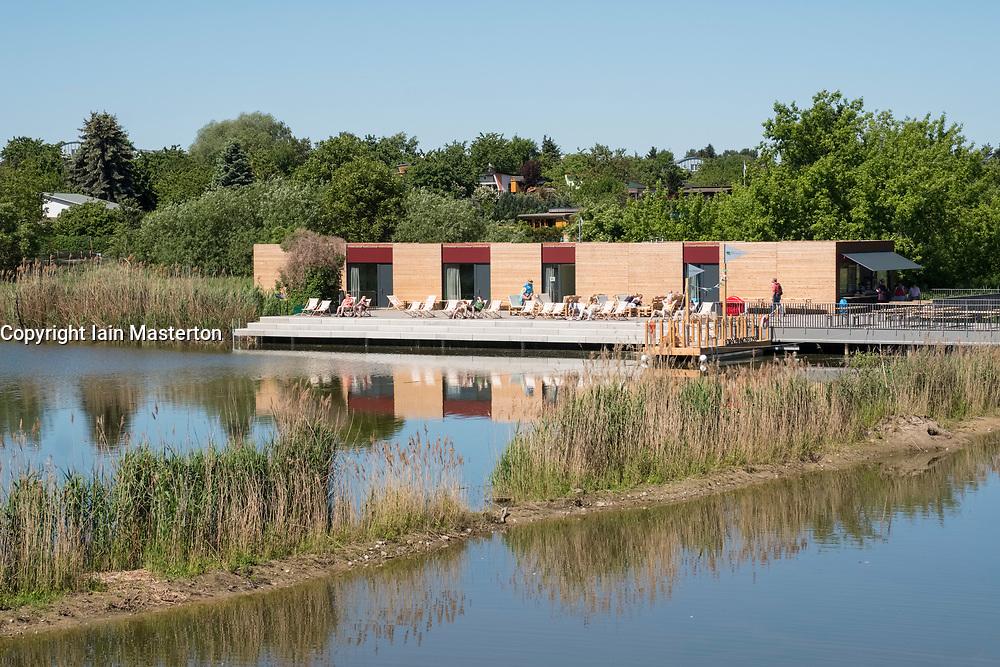 Campis Pavilion outdoor cafe overlooking wetland and pond at IGA 2017 International Garden Festival (International Garten Ausstellung) in Berlin, Germany