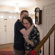ROCKVILLE, MD - JUL25: John Bucknam, 18, who has autism, hugs his mom Barbara July 25, 2014, in Rockville, MD. The Bucknam's have a series of locks on their doors to keep John from wandering off. (Photo by Evelyn Hockstein/For The Washington Post)