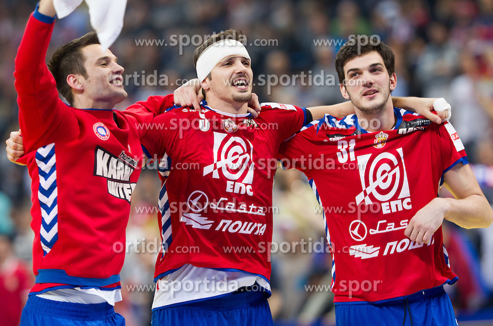 Dobrivoje Markovic of Serbia, Nikola Manojlovic of Serbia and Petar Nenadic of Serbia celebrate after the handball match between Serbia and Croatia in 2nd Semifinal at 10th EHF European Handball Championship Serbia 2012, on January 27, 2012 in Beogradska Arena, Belgrade, Serbia. Serbia defeated Croatia 26-22. (Photo By Vid Ponikvar / Sportida.com)
