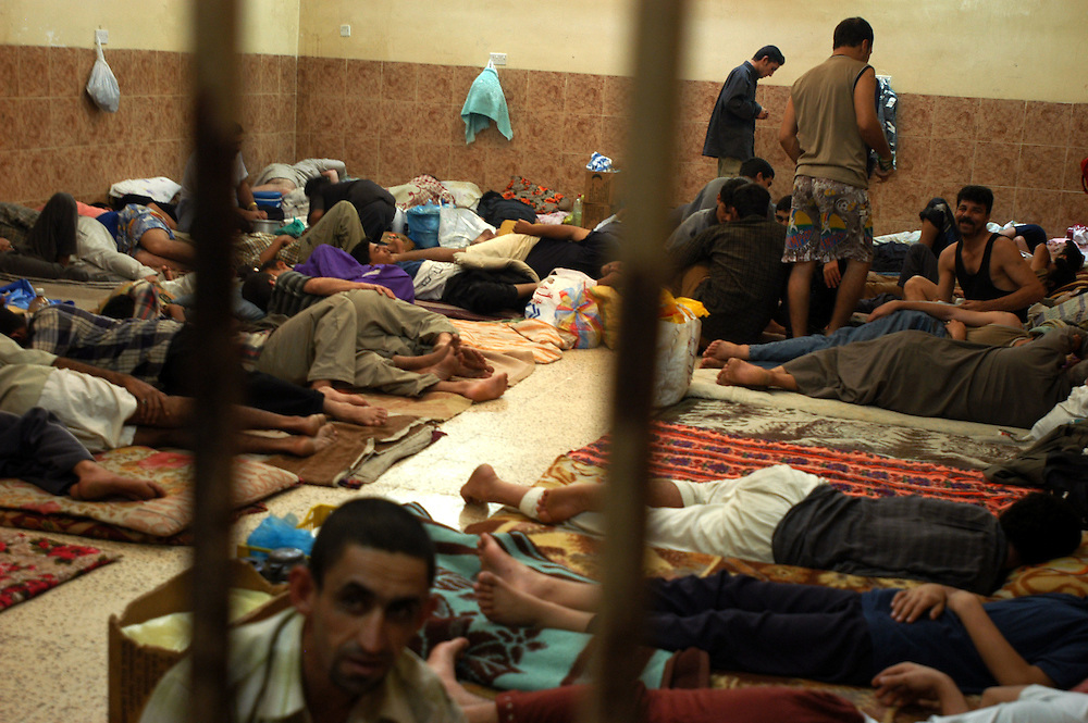Prisoners in the al-Bahya police station waiting to be judged and sentenced. Iraqi police are coming under attack by anti-coalition forces and by the Coalition Provisional Authority to assume more responsibility for security..Baghdad, Iraq. 27/04/2004.Photo © J.B. Russell