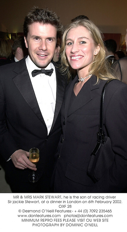 MR & MRS MARK STEWART, he is the son of racing driver Sir jackie Stewart, at a dinner in London on 6th February 2002.	OXF 28