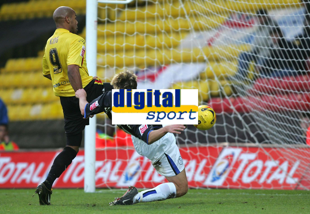 Photo: Frances Leader.<br />Watford v Sheffield Wednesday. Coca Cola Championship.<br />19/11/2005.<br />Watford's Marlon King (L) scores the second goal in the first half as Sheffield's Paul Heckingbottom sits in goal.
