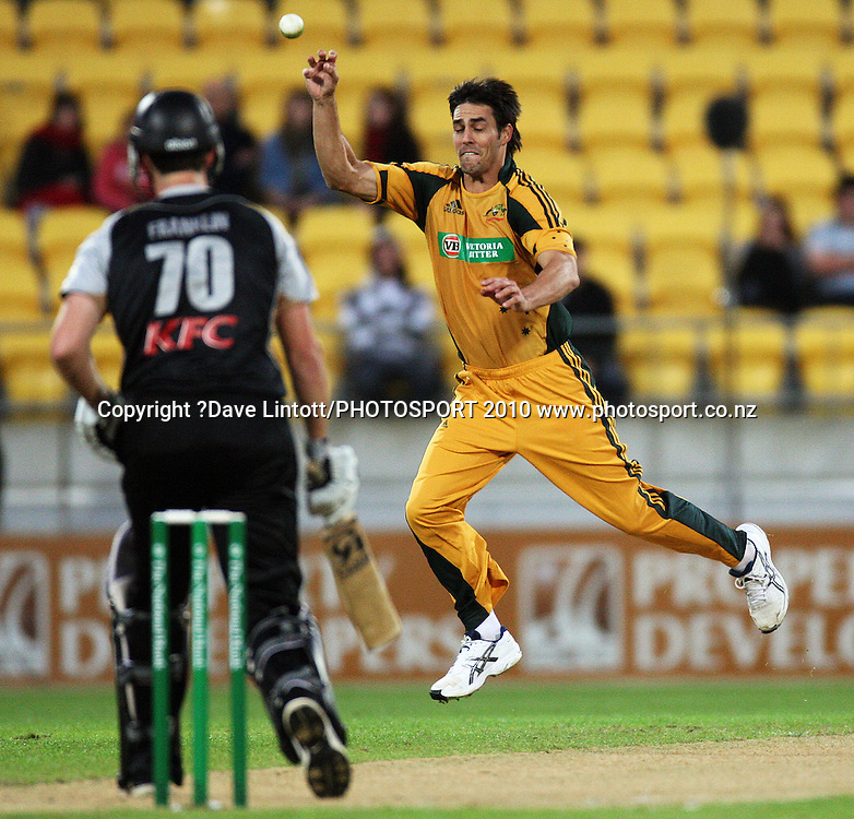 Mitchell Johnson tries to field off his own bowling.<br /> 1st Twenty20 cricket match - New Zealand v Australia at Westpac Stadium, Wellington. Friday, 26 February 2010. Photo: Dave Lintott/PHOTOSPORT