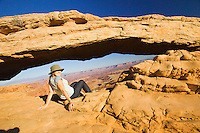 Checking out the view from Mesa Arch, Canyonlands National Park, Utah.
